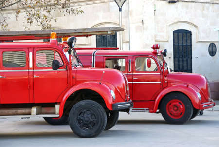 Old red firemen trucks in an exhibition photo