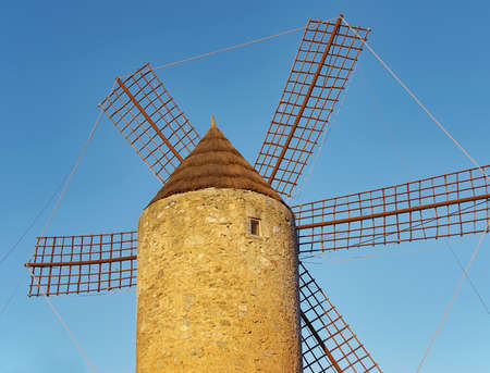Old windmill in a farm of Majorca (Spain) photo