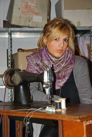 Young Seamstress Girl in front of a sewing machine photo