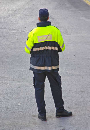 Police Agent patroling by foot in the street Stock Photo - 11515522