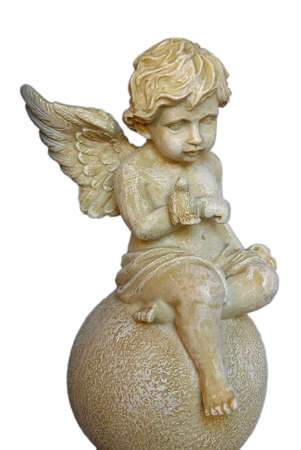 Isolated Angel Boy sculpture sitting over a ball photo