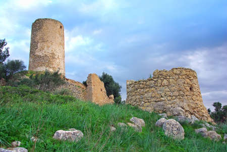 Ancient windmill ruins in the countryside of Majorca photo