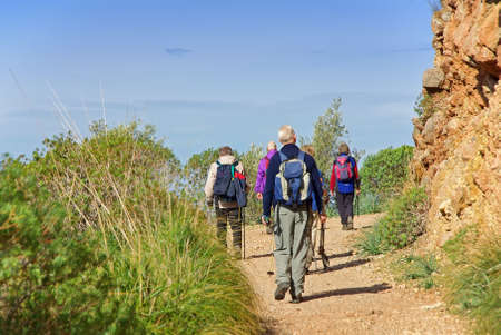 Tourists practising trekking in the mountains of Majorca (Spain)
