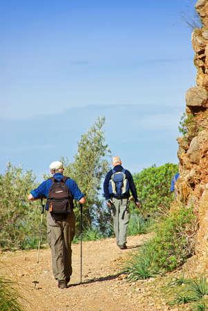 Tourists practising trekking in Majorca (Spain) photo