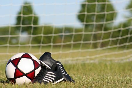 soccer cleats: Soccer ball and cleats