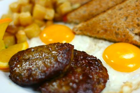 Two eggs with sausage patties