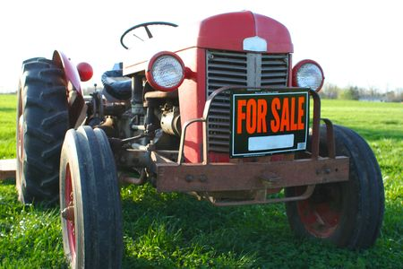 sell: A farmer trying to sell an old tractor