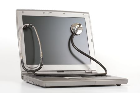 Stethoscope on a laptop - Tech support concept photo