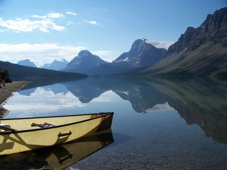 A canoe floats on Bow Lake. Stock Photo