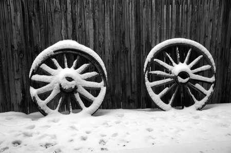 old wood farm wagon: Snow with Wagon Wheels Stock Photo