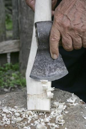 Azeri man fine-tuning the fit of a new axe handle in the small village of Qalaciq, Azerbaijan