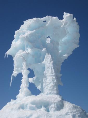 An ice column juts into a winter