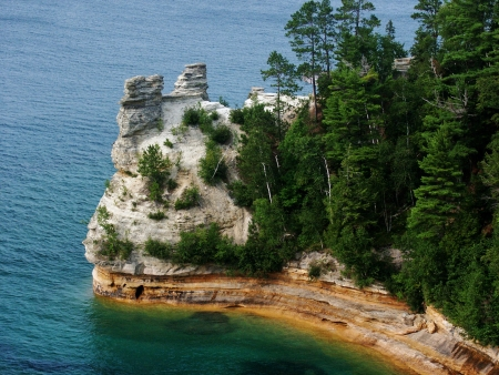 Bright colors paint the shoreline of Pictured Rocks National Lakeshore on Lake Superior  Stock Photo