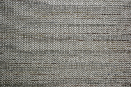 Tan fabric forms an abstract pattern