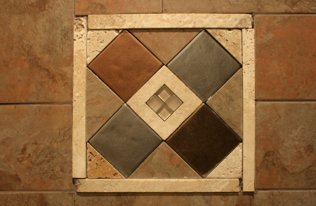 inlaid: An inlaid decorative wall tile graces the wall in an abstract pattern