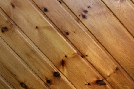Scuffed pine paneling forms an abstract pattern