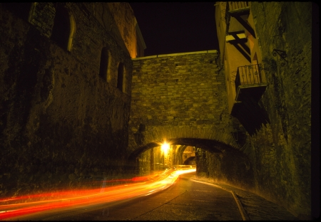 Vehicle taillights trail into an underground street in Guanajuato, Mexico  Stock Photo
