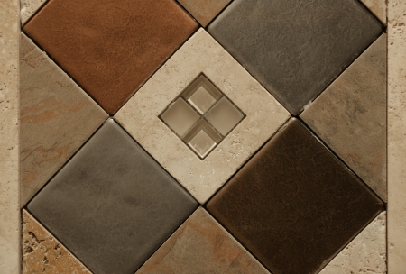 inlaid: An inlaid decorative tile graces a bathroom wall as an abstract pattern