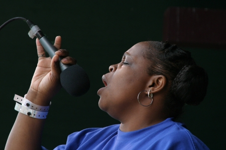 A member of the Gospel group The Tornadoes reverently sings a powerful praise song.