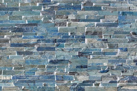 Flagstone bricks form an abstract pattern around a fireplace  Stock Photo