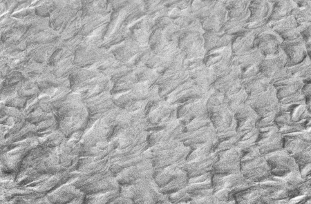 Sand and sea interact along the Mexican Pacific coast near Acapulco to create an abstract pattern  Stock Photo