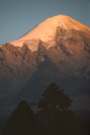 The setting sun paints the Pico de Orizaba pink before dropping behind the horizon