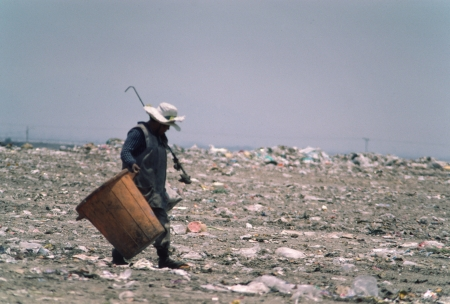 A garbage picker walks to work at a Mexico City garbage dump.