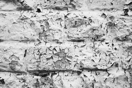 Flaking paint on building blocks creates an abstract pattern