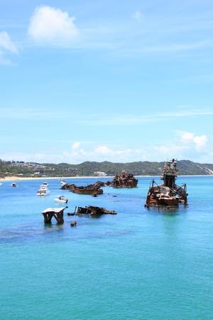 sunken boat: Sunken Wrecks off a tropical Island