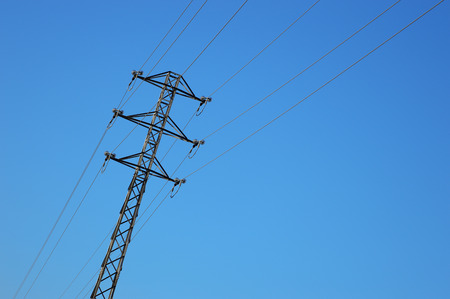 megawatt: high voltage tower against the sky.