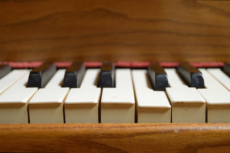 editors: Selective focus image from the up front view of an old wooden piano. Blank copy space for editors text Stock Photo