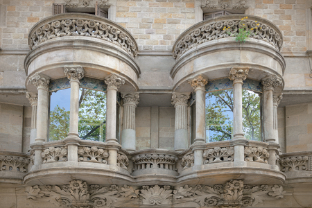 simetry: Two modernist style balconies. Ancient architecture. Symmetry.