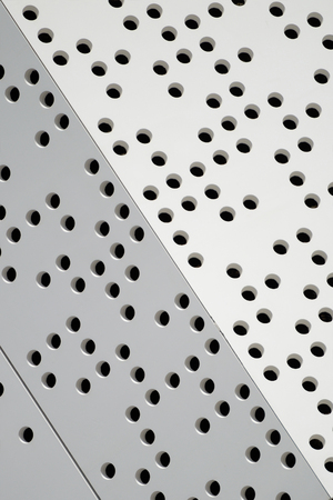 defining: Diagonal dots defining an abstract modern architecture background. Empty copy space for editors text. Stock Photo