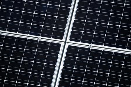 sun energy: Solar panels producing renovable energy from the sun Stock Photo