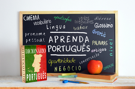verbs: Blackboard in a language class with the text LEARN PORTUGUESE