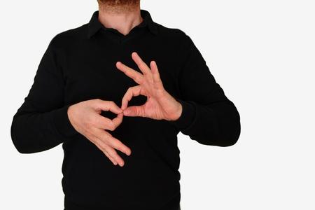 Intérprete de lenguaje de señas que se traduce al encuentro del hombre con ASL, lenguaje de señas americano. Espacio de copia vacía para el contenido del Editor. Foto de archivo