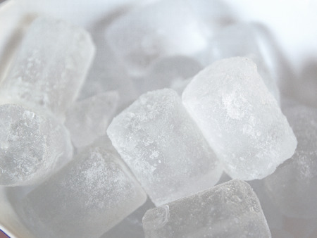 refrigerate: Some white water ice cubes on a bowl.