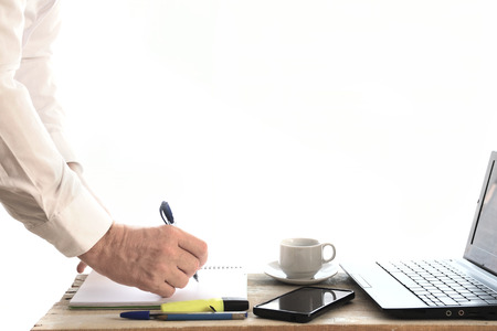 Business man working in a project on a desktop. Office interior. Empty copy space for Publisher's text. Banque d'images