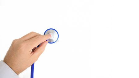 Doctor holding a stethoscope against a white background. Empty copy space for Publisher's text.