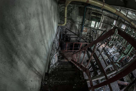 Old rusty stairs in an abandoned factory
