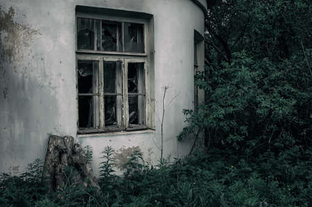 Old dark abandoned house in the forest