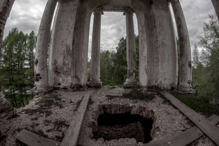 Belfry with columns and a hole in the floor in an old abandoned church