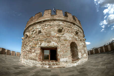 Small circular annex on top of an ancient tower