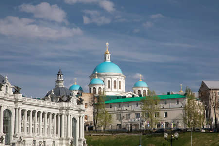 A beautiful large church with blue domes. Palace and ancient architecture. Sunny day. Blue sky.