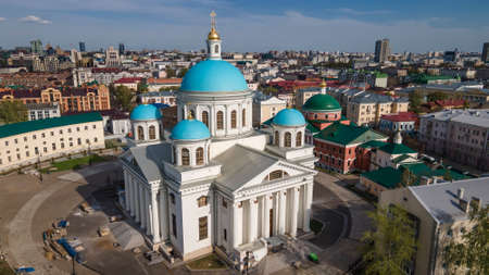 A beautiful church with blue domes. City landscape. Colorful city and church.