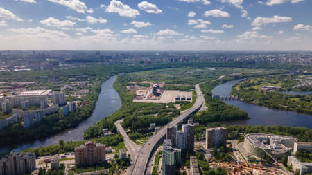 Beautiful city landscape from above. Tall houses and green parks. Sunny day. Beautiful city.