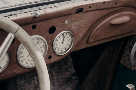 Old cabin of a rusty abandoned truck. Steering wheel and dashboard. Forgotten and abandoned car.