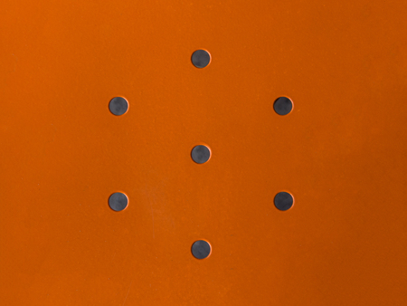 hard alloy: Orange metal with design holes in the center