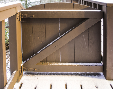 oregon  snow: Brown wooden gate with snow close up