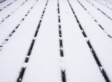 converging: Wooden deck covered with snow converging lines with shallow depth of field